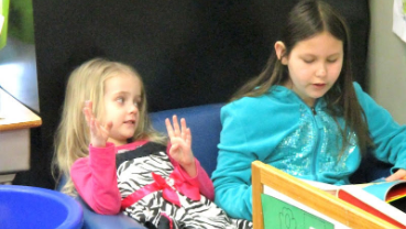 Third-graders at Springmill STEM share reading with preschoolers