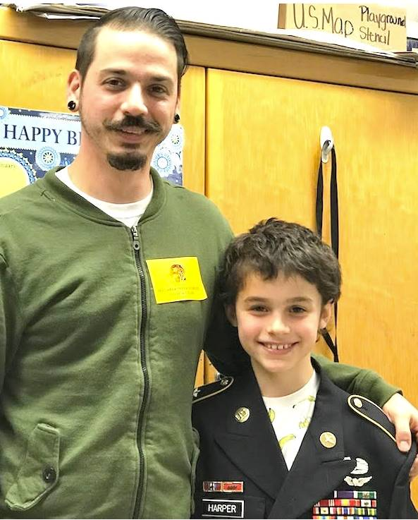 Retired Staff Sgt. Kevin Harper & son, Izaiah celebrate Veteran's Day with Mrs. Foley's Clas