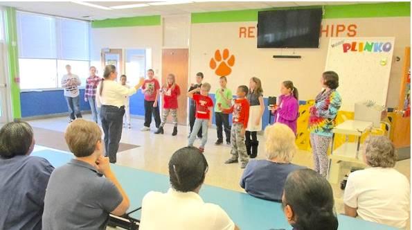Handbell Choir serenades the Cafeteria Staff