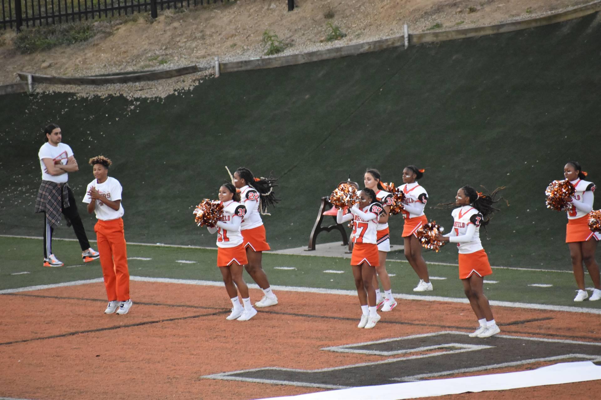 Cheerleaders performing at Homecoming game