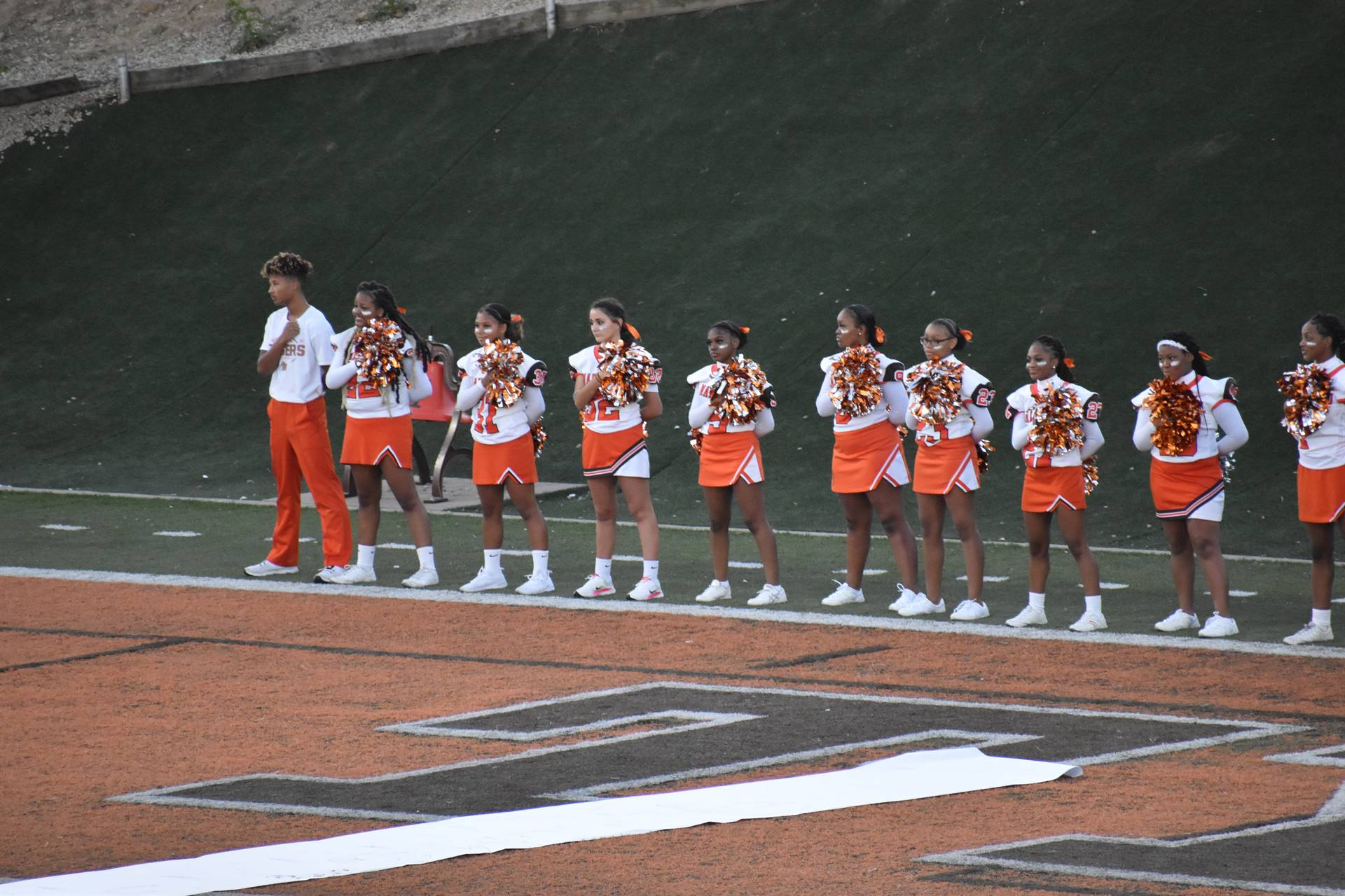 Cheerleaders during National Anthem at Homecoming Game