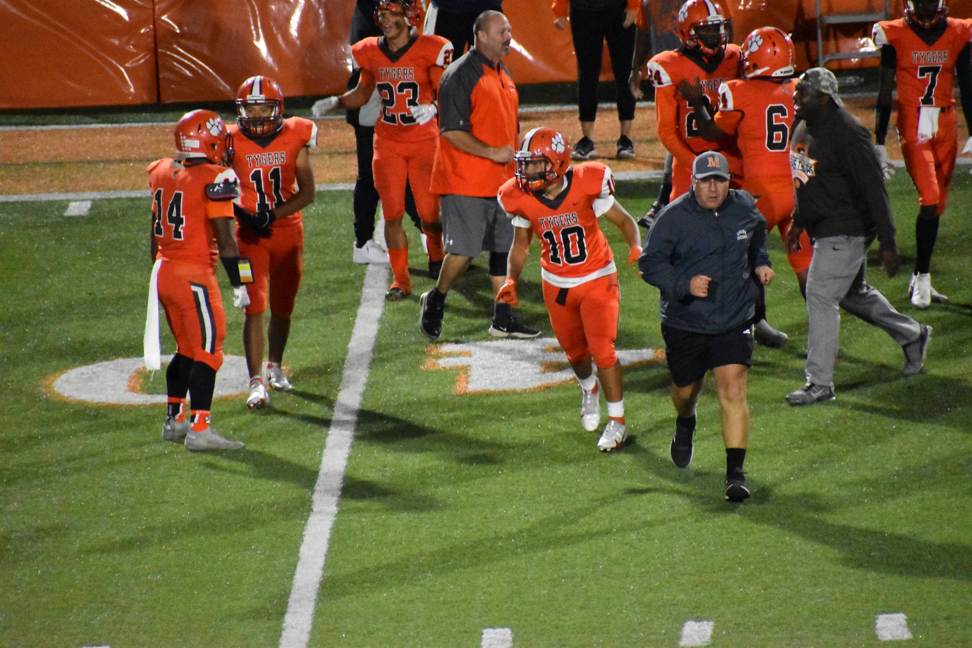 Players at homecoming Game with coaches